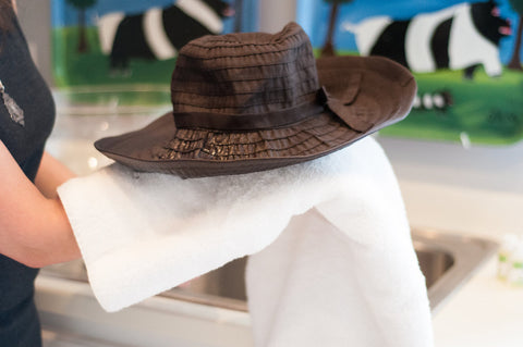 Try to reshape your hat and let it dry flat for best results.