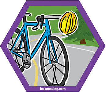 Blue road bike with yellow helmet on hexagon magnet, I'm amazing magnetic personality