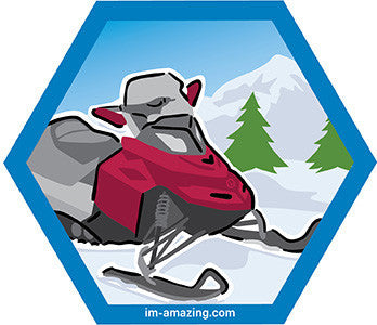 snowmobile on snow on hexagon magnet