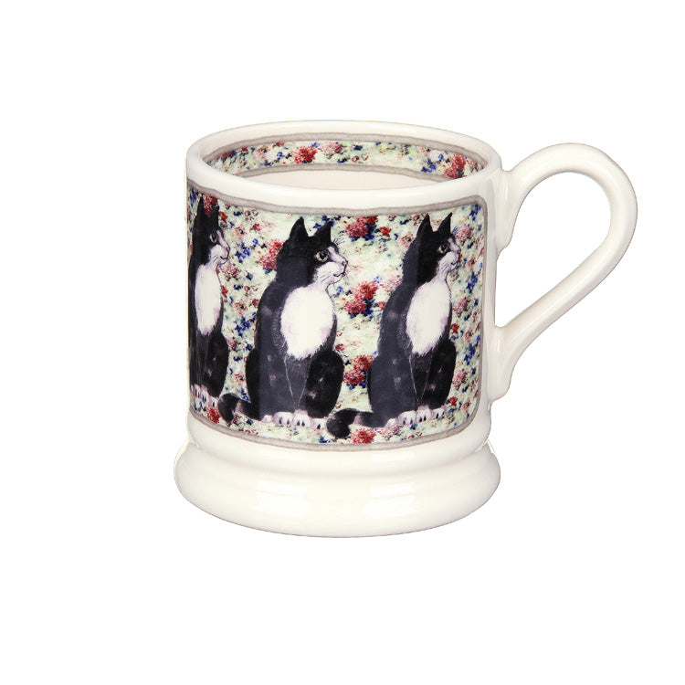 BLACK & WHITE CAT ON RUG MUG
