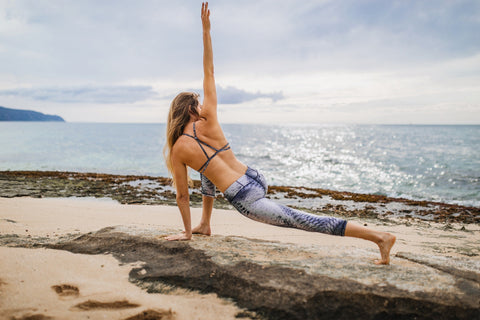 woman doing stretching exercises on a beach