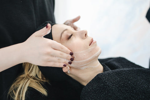 woman having facial care session