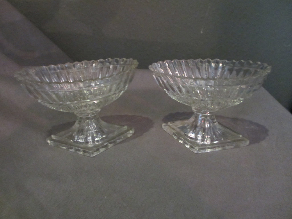 Pair of glass salts with diamond base and oval bowls, antique c.1810.