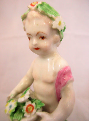 Small Porcelain Figure of a Flower Boy Antique 19th Century.