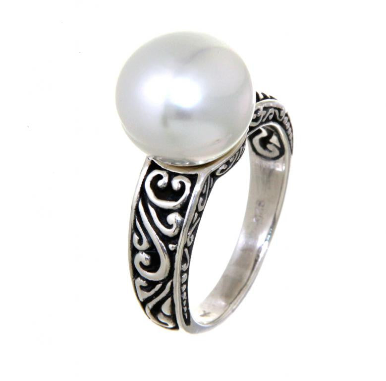 Sterling silver carved pearl ring