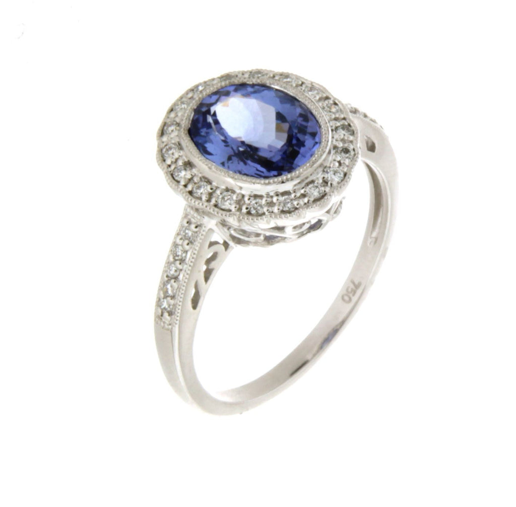 18ct white gold oval Tanzanite & bezel set diamond cluster ring