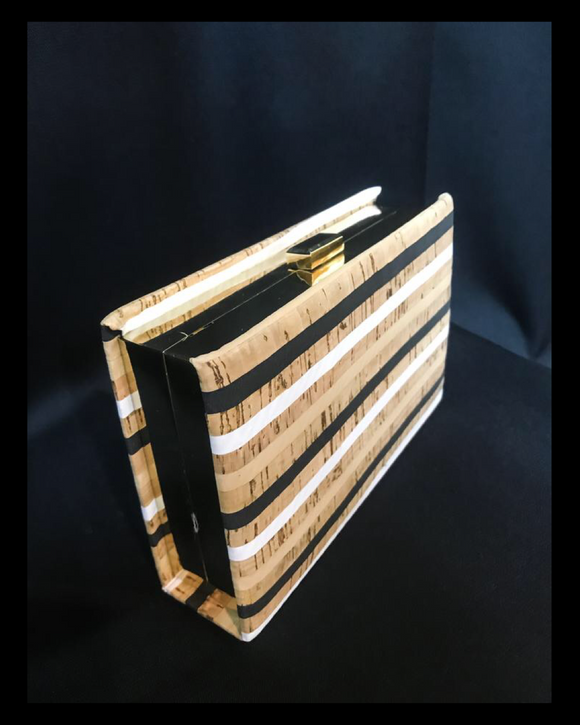 Bamboo look striped clutch