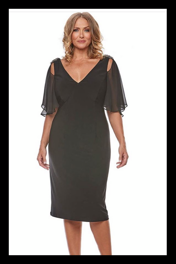 Plus size model wearing a black cocktail dress with v-neck, beaded shoulder detail and floaty chiffon cold shoulder sleeves