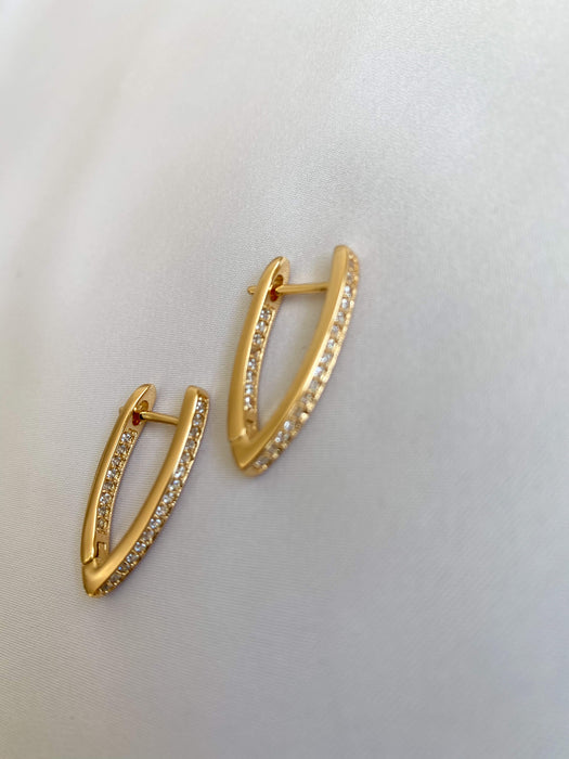 Gold earrings with stone details