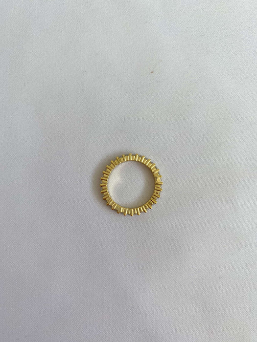 Gold ring with white stones