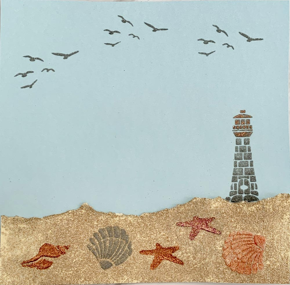 Seaside themed picture with seaside stencil, glittery sand and embellishments by Glitzcraft