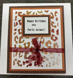 leopard print stencil seen as  background for this party animal card  used with Glitzcraft glitter paste