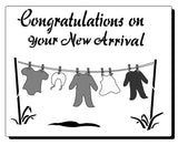 Stencil for New baby - image of baby clothes on wasing line - text reads Congratulations on your New Arrival