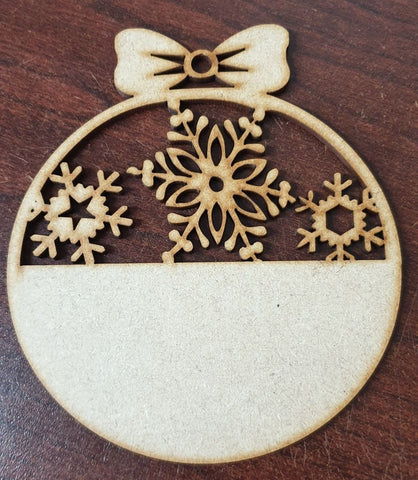 Our MDF  Christmas Bauble is a Laser cut half Snowflake which leaves space to add your own personalisation, so you can add names, dates etc...can be hung on a Christmas Tree or in window etc and can be painted, inked, chalked, distressed or stencilled with Glitter frosting paste.