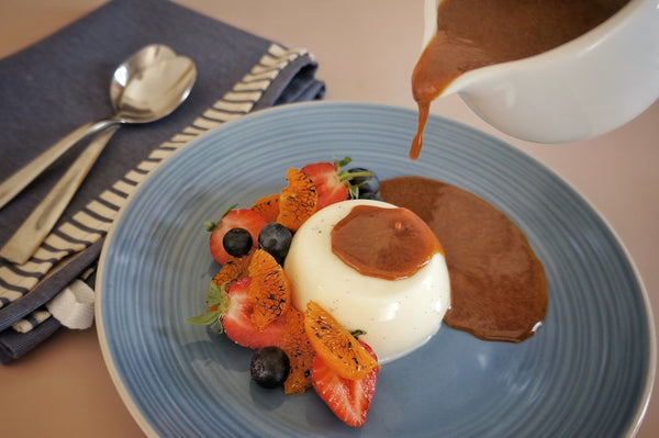 Panna Cotta with berries and Speculaas spiced caramel sauce
