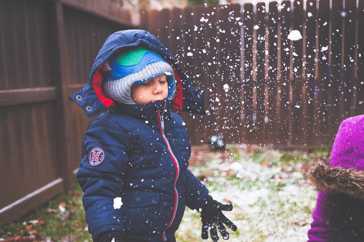 Tips to Keep Your Kids Warm on Your Winter Vacation - Limit layers