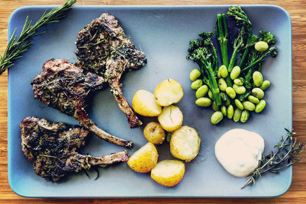 Herb crusted halal lamb chops with broccoli and edamame beans