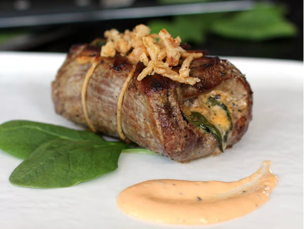 Halal sirloin steak rolls stuffed with crispy onion and spinach