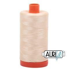 Aurifil 2123 Butter 50 wt available at The Quilt Store