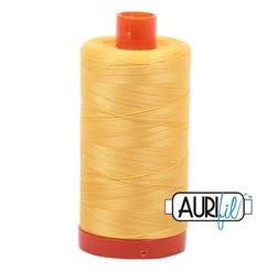Aurifil 1135 Pale Yellow 50 wt available at The Quilt Store
