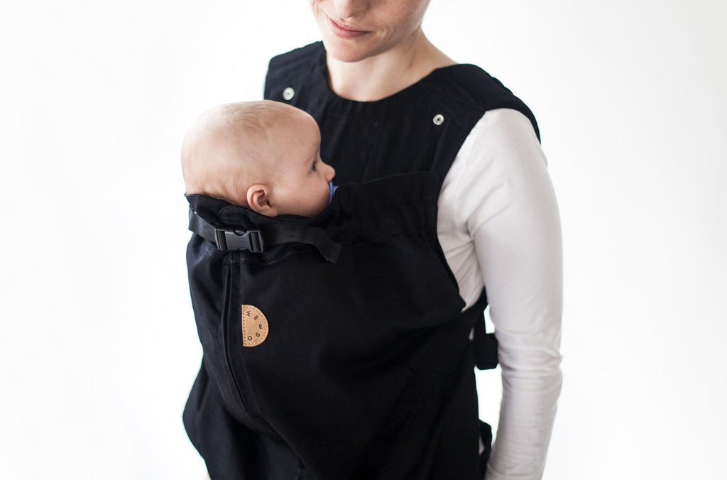 woman carrying baby on her chest in weego original soft baby carrier