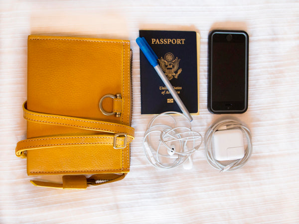 How to pack your Sapahn bag for the plane. Marianne crossbody, phone, headphone, passport, pen