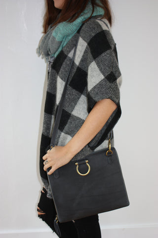 Model wearing Sapahn's M Crossbody bag