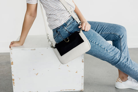 AE crossbody and wristlet wallet in smoke oil and black raw leather.