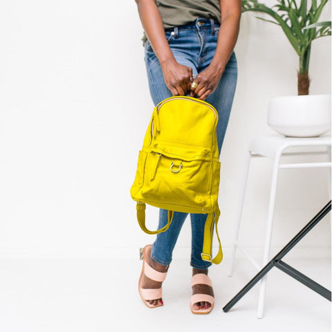 Illuminating yellow makes a great pop of color with a neutral outfit