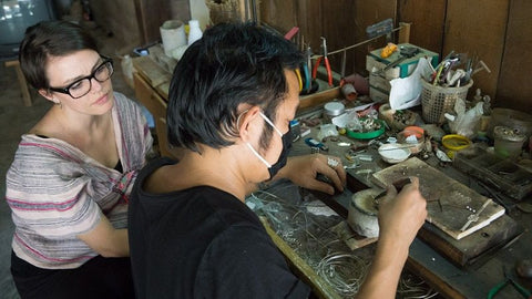 Silversmith Annuluck working on a Sapahn silver jewelry piece