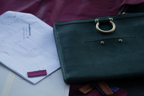 Sapahn's M Crossbody bag with design sketches