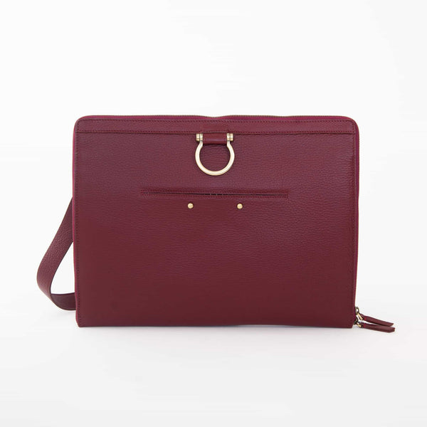 The M XL crossbody bag in deep red oil leather has a zip enclosure, front exterior stud pocket, and Omega hardware.