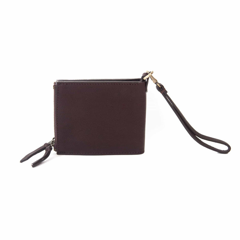 The Noelle billfold wristlet wallet in chocolate brown raw leather has a clean, classic look.