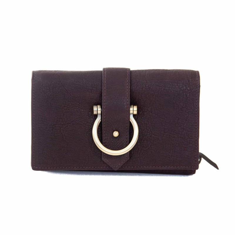 The Staney in chocolate brown raw leather is a minimal wallet, wristlet, belt bag, and crossbody bag all in one.