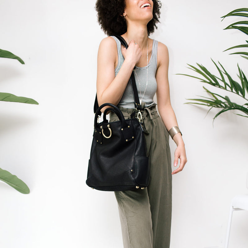 Carry the Chloe convertible black leather bag with an adjustable strap as a sling purse.