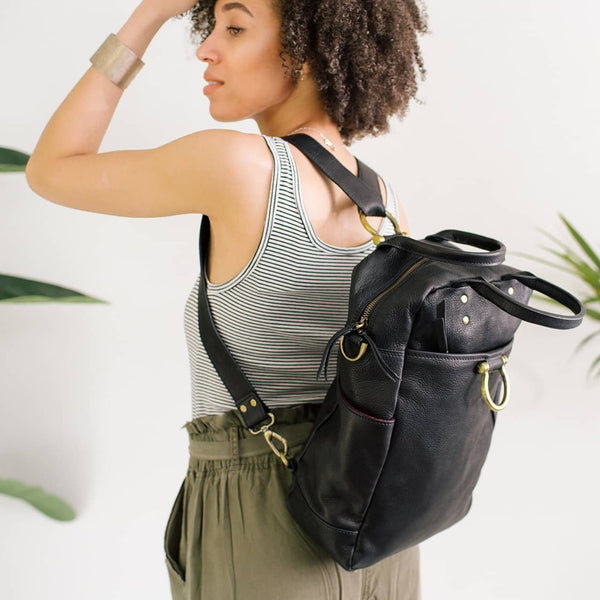 Wear the Rodica leather bag in black raw leather as a backpack.
