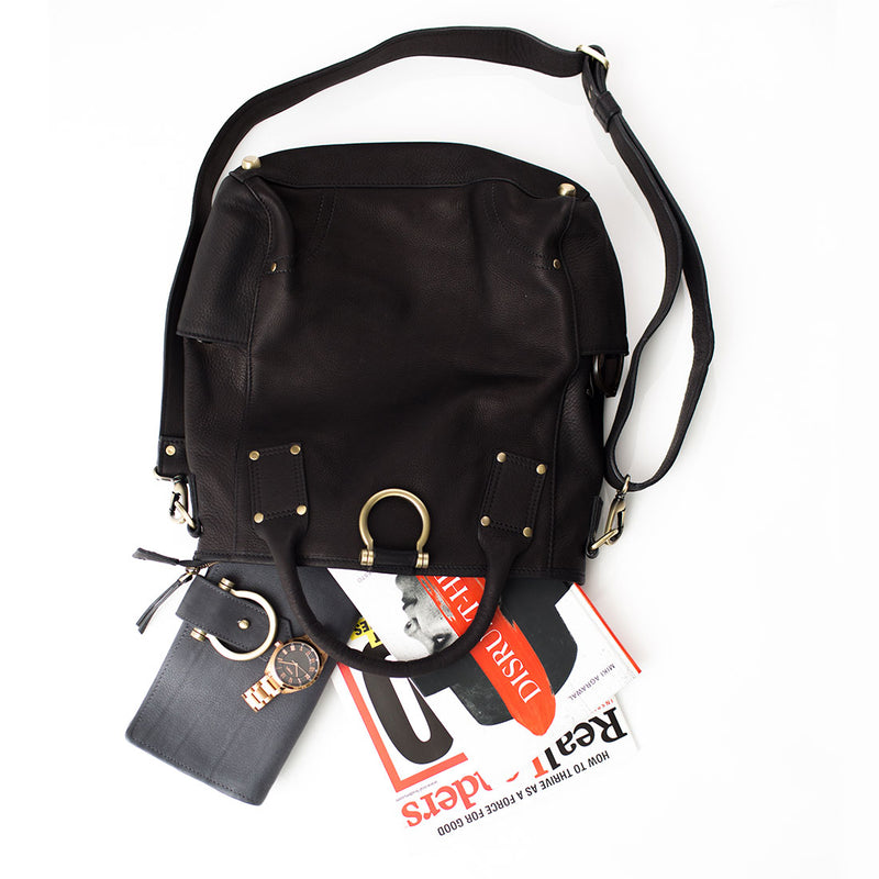 Black Chloe leather crossbody backpack bag fits your everyday essentials.