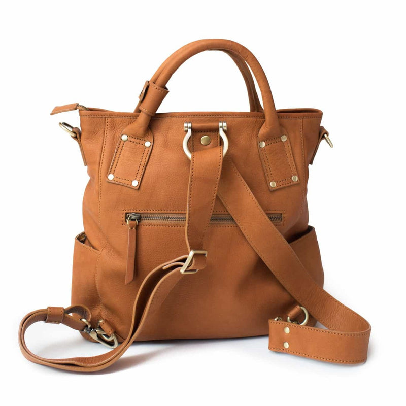 Whisky tan Chloe leather crossbody backpack with top handles, zippered closure, and side pockets.