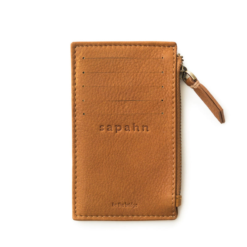 Whiskey tan raw leather Emma card holder wallet features 5 external card slots and a subtle Sapahn logo.