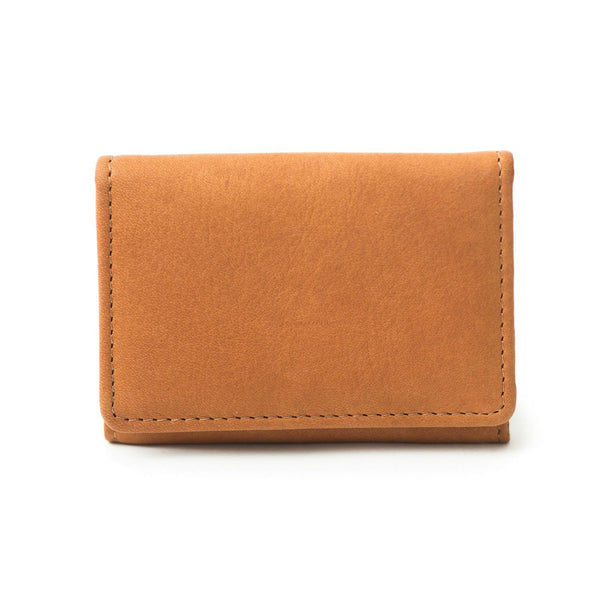 Fisher whisky tan leather card holder exterior is minimal with matching stitching.