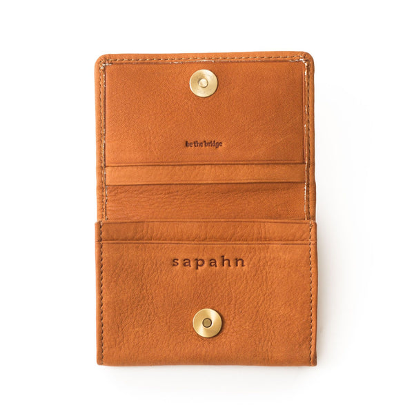 Inside of the Fisher whisky tan leather card holder features 4 card slots; 1 deep slot for business cards. Magnetized closure.