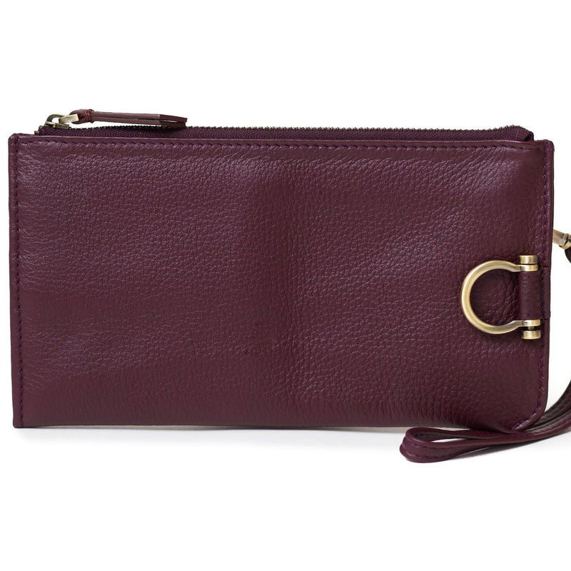 Forten wristlet in biking red oil leather features a minimal exterior with Omega brass hardware.