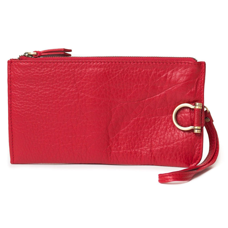 Forten wristlet in chili pepper red oil leather features a minimal exterior with Omega brass hardware.