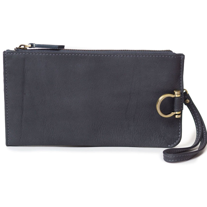 Forten wristlet in gray raw leather features a minimal exterior with Omega brass hardware.