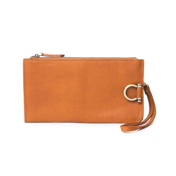 Forten wristlet in whisky tan raw leather features a minimal exterior with Omega brass hardware.