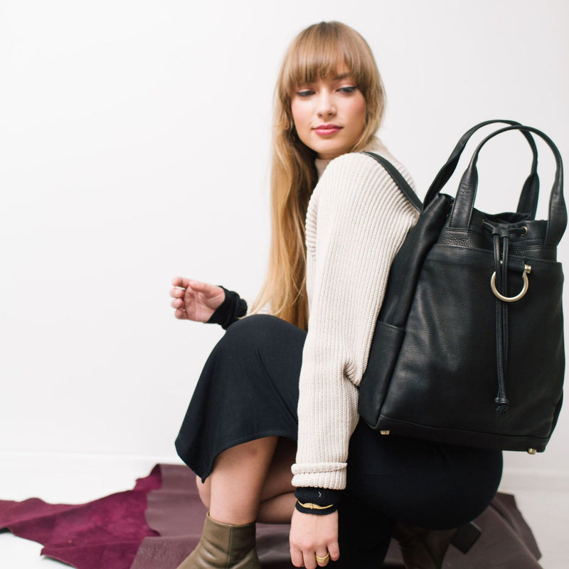 Versatile black leather backpack for school, work, travel, or as a diaper bag