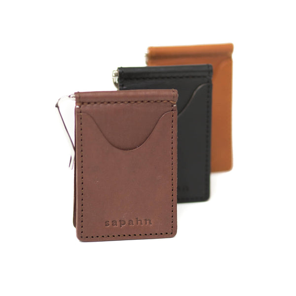 Three Dale leather money clips with exterior card slots in various colors.