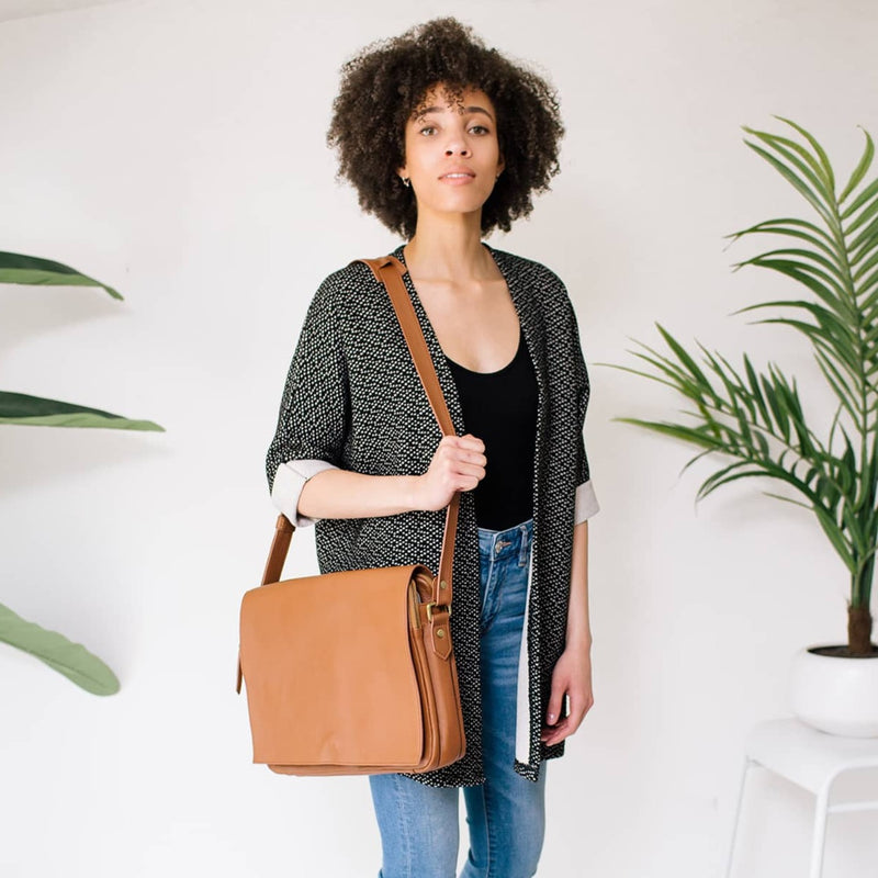 Ford messenger unisex cognac brown oil leather bag features an adjustable strap.