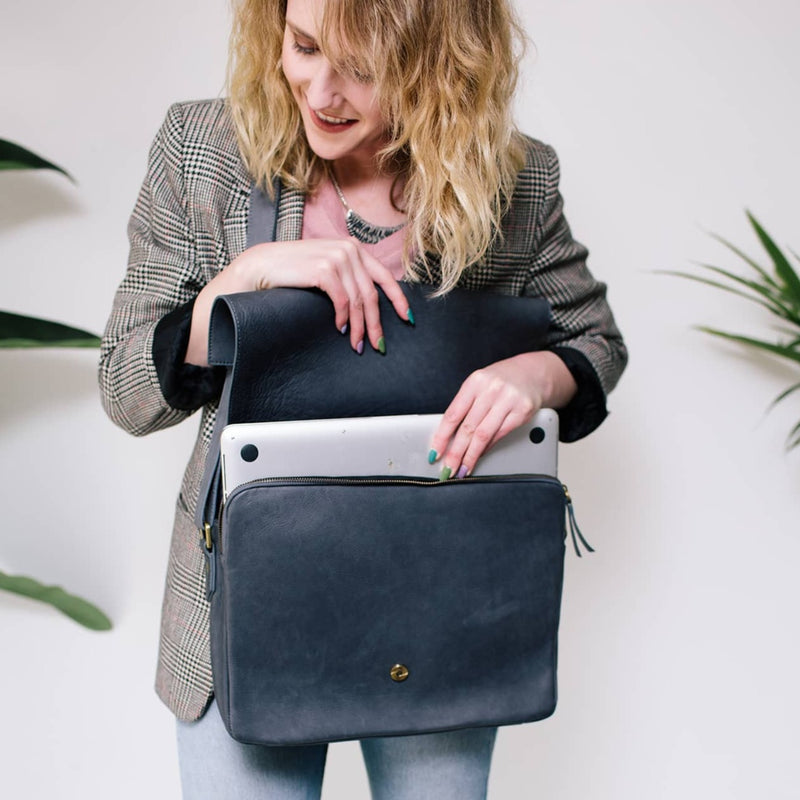 "Ford messenger unisex gray raw leather bag fits a 15"" laptop and has a magnetic flap closure."
