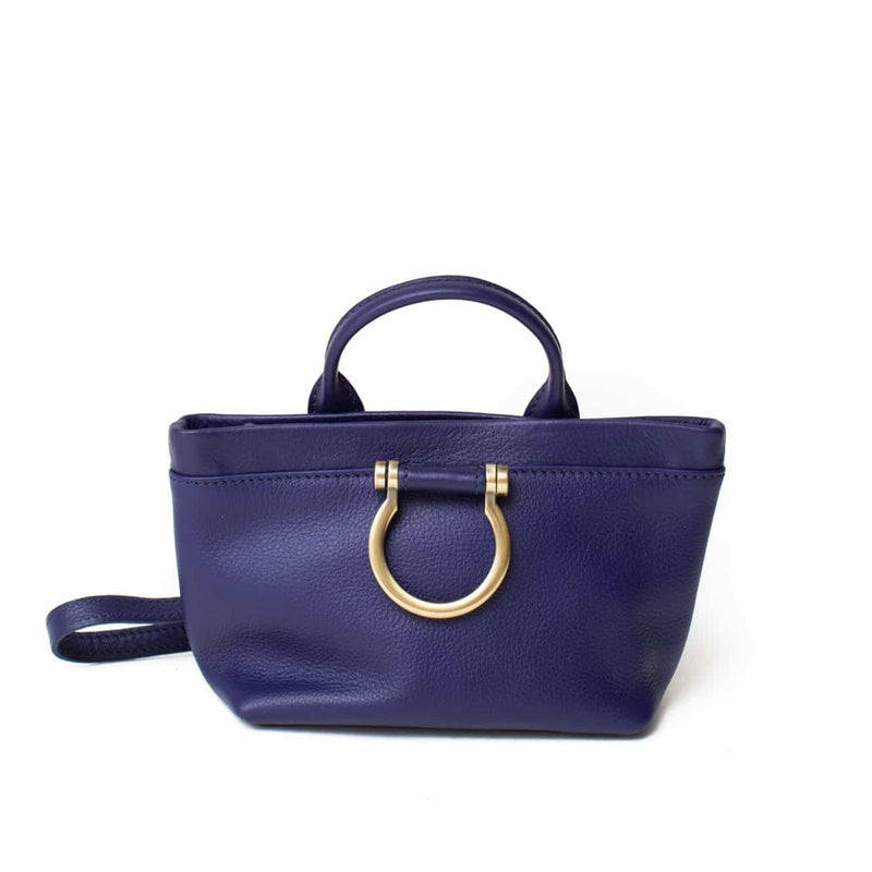 The Roger mini crossbody in admiral blue oil leather features a top handle and Omega plated brass hardware.